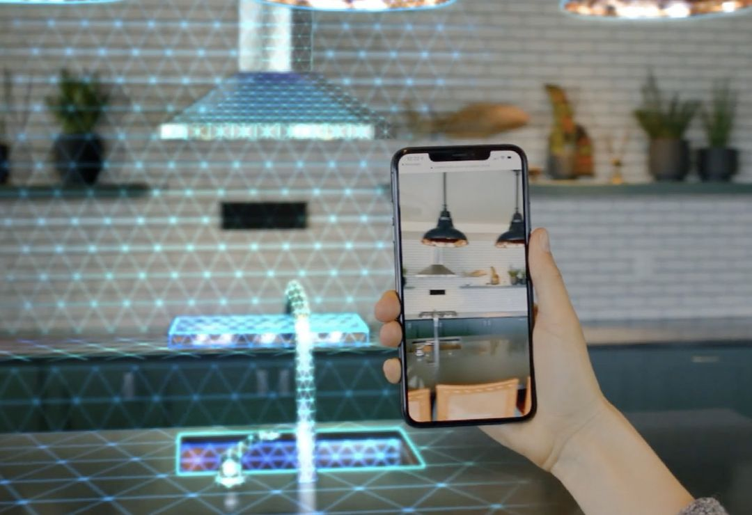 A user holds an iPhone with Streem remote video and 3D meshing